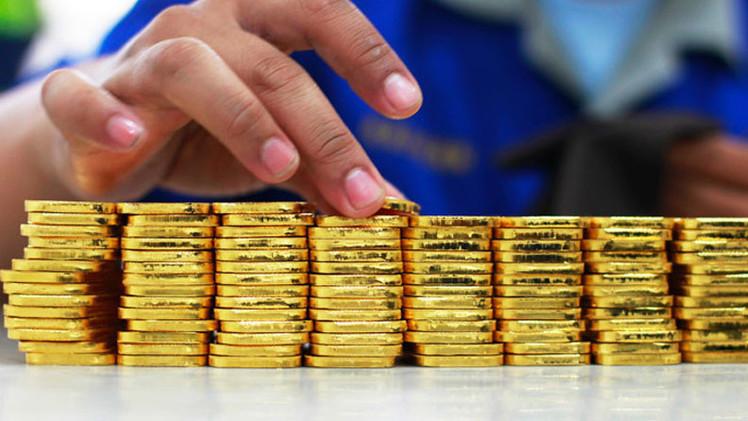 Subida dr�stica del precio del oro, �escudo contra el d�lar y euro d�biles?