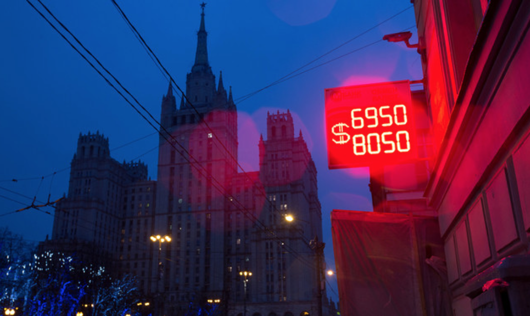 Ruble Slides Past 70 Per Dollar After Russia�s Surprise Rate Cut