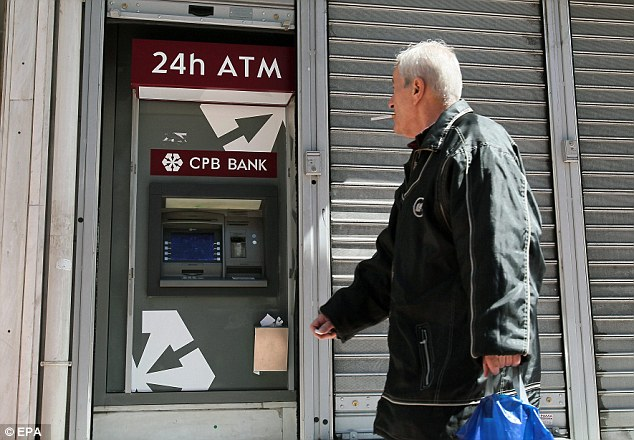 Greece introduces cashpoint tax in desperate bid to raise revenue and stop run on banks as country teeters on brink of bankruptcy