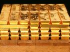 Gold Futures Climb on Dollar Weakness to Falling Stocks