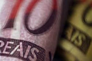 brazil�s real tumbles to five-year low as rousseff gains support