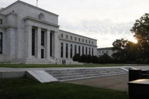 specter of a deflation world looms over fed's return to normal