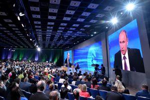 putin strikes uncompromising tone over crisis hitting russia