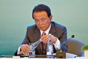japan finance minister aso: closely watching china's economy, falling yuan
